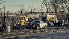 Peter's Scrap Yard (keidong) Tags: scrapyard junkyard mercercounty trenton nj cars sign cobblestones schoolbus bus railroadtracks minoltaxk