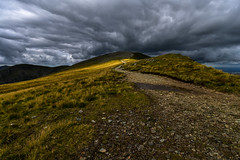 A light in the dark ( Explored ) (trojanhorse1956) Tags: wales mountains hillwalking snowdonia clouds path hiking carneddau sunlight storm