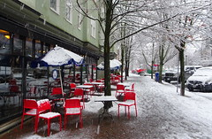Hot reds to cheer you up on a cold, snowy day! (peggyhr) Tags: peggyhr chairs tables umbrellas snow red trees sidewalk footprints nvancouver bc canada white dsc04981a reflections thegalaxy thegalaxystars