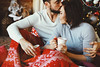 Magic,k (Nnoti Nastenkina) Tags: couple love unfocused xmas holidays kiss cosy cute care winter xmastree joy hug women men lights bokeh red sweet tea coffee cup beauty russia studio decorations family smile
