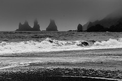 The beach at Vík (reedited) (trochford) Tags: coast coastline shore shoreline basalt stack column sea seastack wave surf blacksand blackbeach beach fog mist overcast reynisdrangar vík vik iceland canon outdoor bw bnw blackandwhite blackwhite noiretblanc blancoynegro mono monochrome