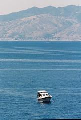 Fishing. Scilla. Italy, June 17 (arsenterzyan) Tags: bay ektar100 kodak eos3 canon arsent 70200 grain film analog 35mm travel italy yacht ship water fishing boat scilla sea