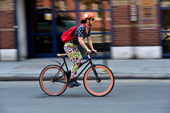 Colour cycle (jeremyhughes) Tags: bike road london street cycling cyclist orange blue speed panning motion movement bicyle fixie fixed fixedgear fixedwheel deeprims commuter colour color colourful colorful helmet shades sunglasses urban city nikon d750 nikkor 80200mmf28