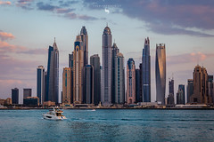 Feel the evening in Dubai (hisalman) Tags: dubai marina towers buildings highrise salmanahmed canon clouds weather uae boat yatch sea water cityscape landscape seascape