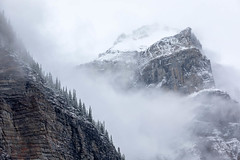 Decloaking (Kirk Lougheed) Tags: alberta banff banffnationalpark canada canadian morainelake valleyofthetenpeaks autumn cloud fall forest landscape mountain nationalpark outdoor park peak sky summit tree