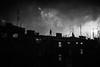 New Years Eve Showdown 122.365 (ewitsoe) Tags: newyearseve ny2018 poznan poland rooftop fireworks monochrome bnw blackandwhite 365 122 ewitsoe canon eos 6dii 50mm winter cityscape cinematic cinema film silhouette man sky clouds urban scene polska jezyce europe visitpoland