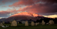 Blencathra and Castlerigg Stone Circle at Sunset (NDSD) Tags: cumbria lakes lake district mountain ranges mountains sun orange pink landscape contrast sky blue clouds water view panorama pano vista sundown sunset night natural beauty light lights dark darkness scenic scenery setting england hills horizon northern north evening dusk sunlight blencathra saddleback pikes great rocks reflection reflect snow ice stone circle castlerigg henge standing monument ancient bc 3000 gods worship