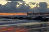 Waves, clouds and sunset in Marina di Massa (Darea62) Tags: sunset seascape clouds skyscape bridge tramonto marinadimassa skyporn pier jetty streetlights beach tuscany stones reflections toscana travel waves longexposure