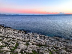 Gazing beyond the rocks_IMG_6116n (AchillWandering) Tags: coast ciel blue rocks water
