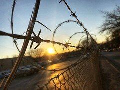 5/365 (moke076) Tags: 2018 365 project 365project project365 oneaday photoaday iphone cell cellphone mobile reynoldstown atlanta ga barbed wire fence metla sunset warm glow evening winter parking lot