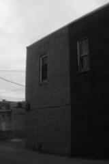 White and Black Building (Sean Anderson Media) Tags: oldbuilding blackandwhite brickbuilding smalltown lofi lofilens plasticlens holgalens building alley monochrome architecture holgafisheyeadapter canonrebelt2i