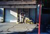 New tires low prices (ADMurr) Tags: memphis tn new tires rims garage waiting area red pole cement tilt leica m6 50mm summicron kodak ektar dab305