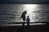 Lucas and Mom in beautiful sunset (Tianqiang) Tags: silhouette canonef24105mmf4lisusm tahoe lake sunset kingsbeach california unitedstates