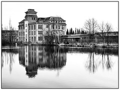 Winter in Freiberg (unukorno) Tags: freiberg sachsen deutschland porzellanwerk porzelline lake teich building trees winter reflection spiegelung water wasser bw blackwhite sw monochrome frame rahmen ruin ruine abandonedplace industry industrieruine