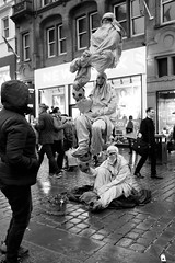 hows that done (LozHudson) Tags: fuji x100s fujifilmx100s mono monochrome blackwhite blackandwhite manchester streetperformers illusionist trick street streetphotography