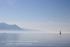 farewell 2017 (overthemoon) Tags: switzerland suisse schweiz svizzera romandie vaud lake léman boats mist savoie mountains alps blue water sky lakegeneva lacléman sails greetings newyear vevey