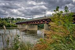 Owego Bridge (FotoFloridian) Tags: architecture autumn bridge builtstructure clouds hdr newyork outdoors owego river scenics sony susquehanna transportation travel a6000 alpha landscape nature sky water