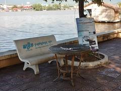 DSCN7778 (mikecogh) Tags: kampot bench table concrete riverside sponsor advertising praektuekchhuriver wicker