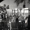 Vetrina di un ristorante sul mare (paolapaoletta) Tags: agfaclicki clicki blackandwhite biancoenero tetenalparanols 125 1120° lungomare seafront vetrina window ristorante restaurant vallecrosia liguria italy ilfordfp4plus fp4 125iso