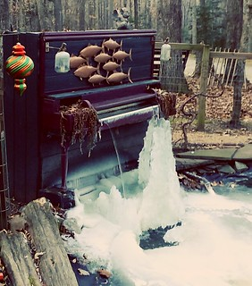 Piano waterfall with ice flowing.