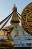 Buddhist golden deer and wheel of Life in front of  Boudhanath Stupa, Kathmandu, Nepal (Alex_Saurel) Tags: statue pigeon asie culture 35mmprint scans asian bird stupa bouddhisme oiseau birds buddhism eyesofboudhanath oiseaux khāsacaitya boudhanath mandala asia prayerflags gildedstatue khāsti architecture travel sanctuairebouddhiste deer statuededaim बौद्धनाथ buddhiststupa imagetype buddhistsanctuary photospecs photoreport jarungkhashor yeux drapeauàprière daimdoré kathmandu photoreportage thegreatstupa reportage bouddhanath eyes buddhistsymbol bodnath byarungkhashor photojournalism stûpa religion goldendeer stockcategories dharmachakra day time tibetanflags katmandou tradition nepal sony50mmf14sal50f14