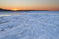 Sunset on Ice (brucetopher) Tags: sunset ice cold winter beach frozen freeze freezing icy icey sea ocean bay iceberg seaice chunk glow afterglow
