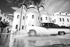 La Habana in Black and White (Geraint Rowland Photography) Tags: blackandwhite bw blackandwhitehavana lahabana cuba cubancars carsincuba havana blackandwhitetravelphotography actionphotography highspeedphotography fastshutterspeed canon travelincuba latinamerica church architecture beautyinphotography geraintrowlandcubanphotography wwwgeraintrowlandcouk cars classiccars car puddle water freezingmovementinphotography wideangle canon1635mmlens white
