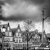 Old houses in Hoorn (DST-photography) Tags: hoorn walk bw black white monochrome dramatic hdr sigma 1750mm nikon d7100 city centre christmas westfriesland lowlands netherlands holland amsterdam clouds weather toren tower hoofdtoren port haven boat people tree sky road building park