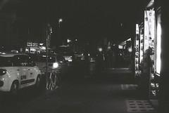 Roma (goodfella2459) Tags: nikon f4 af nikkor 50mm f14d lens kodak trix 400 35mm blackandwhite film analog roma night city shops cars rome italy lights bwfp manilovefilm