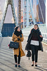 Ladies crossing (Mister Oy) Tags: davegreen oyphotos ©oyphotos salfordquays bbcmediacity nikond850 d800 urban street streetphotography ladies women contrajour light intothelight 85mm nikon85mmf14gafs walking bridge footbridge lowery