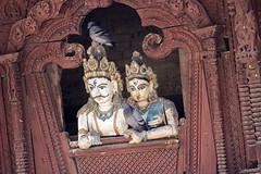 Shiva and Parvati, with pigeons (Tim Brown's Pictures) Tags: nepal kathmandu durbarsquare temples holy hinduism statue woodcarving femalefigure daytime verticalformat shiva parvati shivapartavitemple