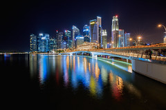 Singapore city skyline by night (Patrick Foto ;)) Tags: architecture asia bay blue bridge building business center central city cityscape commercial concept copyspace district downtown dusk evening exterior famous financial illuminated landmark landscape light marina metropolis modern night outdoors panorama reflection river riverside scene sea singapore sky skyline skyscraper structure tourism tower travel urban view water waterfront sg