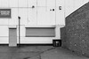 Spareline (Number Johnny 5) Tags: lines tamron cage building industrial minimal space noir door shutters urban mundane angles black architecture banal 2470mm bnw d750 wall nikon documenting white