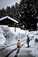 Morning snow road (Ka-merameha) Tags: people street children mother family snow village yellow human japan