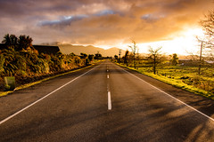 Lonely road to light (amcatena) Tags: yellow sky red sunset light clouds road orange new zealand nz newzealand