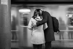 77th Street (John St John Photography) Tags: streetphotography candidphotography 77th street subwaystation 6train mta newyorkcity newyork lexingtonavenue man woman affection embrace kiss train slowshutterspeed blur reflections peopleofnewyork bw blackandwhite blackwhite blackwhitephotos johnstjohn