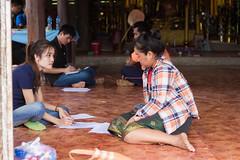 FISHBIO Lao staff interviews local woman