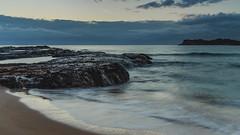Sunrise Seascape (Merrillie) Tags: daybreak landscape nature dawn mountains rocks eurobodallashire maluabay newsouthwales sea water sun batemansbay beach ocean nsw australia waterscape coastal island scenery seascape sunrise coast southcoast clouds