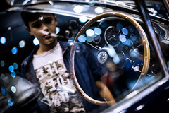 A Boy's Dream - Classic Aston Martin - Dubai Motor Show - Leica M10 (Sparks_157) Tags: car cars window reflection classiccar astonmartin db4 dubaimotorshow2017 show lights bokeh boy motorshow dreams leica m10 rangefinder 50mmf14summilux vintage aspiration steeringwheel dubai uae spotlights kid petrolhead inside outside dashboard