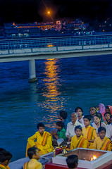 nighttime Hindu ceremony (Pejasar) Tags: ceremony hindu nighttime evening fire pit ganges river light reflection city