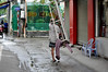 On the move (Roving I) Tags: loads carrying alleyways workers jackets plasticchairs tough danang vietnam