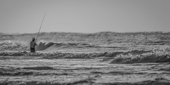 I sure envy this guy about now...-4 outside now! (flintframer) Tags: black white bw people fisherman surf beach gulf shores alabama gulfofmexico nature waves wow dattilo canon eos 7d markii ef600mm monochrome