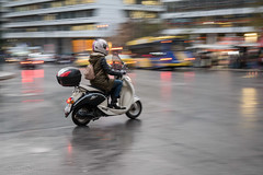 Athens. Rain. (GeorgeDement) Tags: 2017 athens december greece syntagma motocycle panning rain reflections scooter motorcyclist sym mio