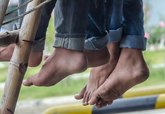 free toes (Pejasar) Tags: barefoot bare feet hanging truck back toes free freedom travel ankle rural candid road punjab india rope bamboo bluejeans
