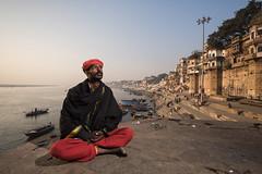 A young sadhu at Varanasi. (Ravikanth K) Tags: 500px sadhu young adult man traditional costume outdoor varanasi kasi india uttarpradesh ganga ganges ghats buildings daytime portrait environmental orange baba people boats water river