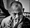 THE SCHOLAR (panache2620) Tags: buddhist meditation scholar monochrome bw candid eos study focused portrait man male canon