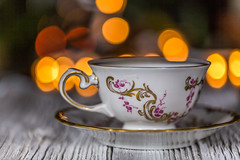 Tea Cup On Saucer (AudioClassic) Tags: wood retro old table china teacup cup retrorevival tea oldfashioned whitebackground antique empty afternoontea gold blue dragon service paint mug elegance fragility food drink liquid macro white individuality relaxation idyllic ceramics comfortable