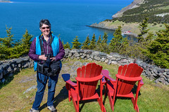 Celina at Fort Royal's Detached Redoubt along with the ubiquitous Canada National Parks red chairs (Brett of Binnshire) Tags: chair historicalsite ocean locationrecorded bay furniture scenic canada shoreline placentia water newfoundland