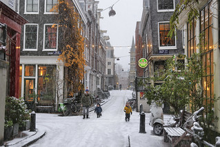 Snowflakes falling in the cold and cosy Jordaan