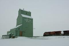 Just passing through (Len Langevin) Tags: alberta train motion grainelevator brandt canada winter nikon d7100 tokina 1224